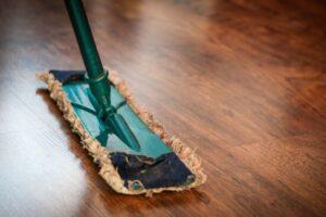 large rectangular broom-mop device glides across gleaming wooden floor